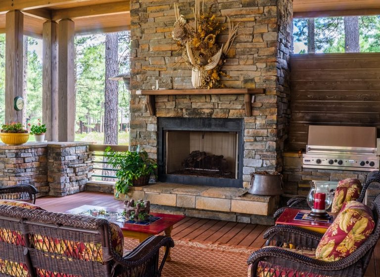 Shown is Buffalo, NY's best large rock solid stone fireplace and chimney in an open modern country rustic living room