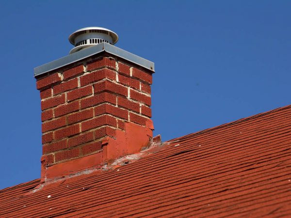 Shown is a brick chimney in Buffalo, NY that has gone through a chimney inspection and has passed.