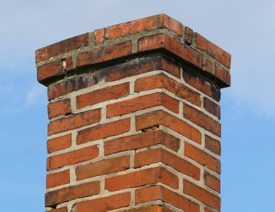 Shown is a red brick chimney in Buffalo, NY that recently completed a chimney sweep.