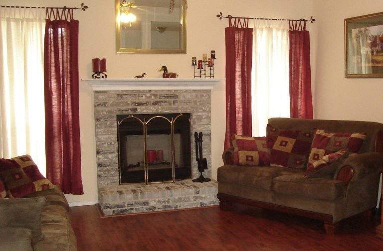 Shown is a white brick fireplace cleaned of creosote in a living room in Buffalo, NY